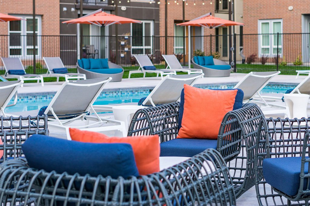 Outdoor pool area with lounge chairs and umbrellas