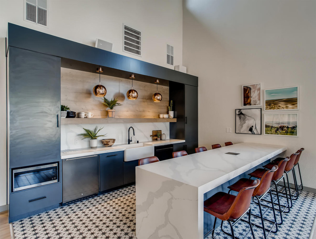 Kitchen with marble counters and dining chairs